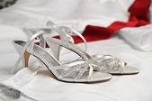 Wedding Shoes on Wedding Dress — Stock Photo