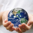 Planet in the hands - Stock Photo