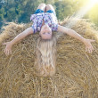 Girl in the hay - Stock Photo