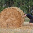 Man pushes a haystack — Stock Photo