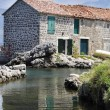 Beautiful stone house with reflection in the water — Stock Photo #14692827