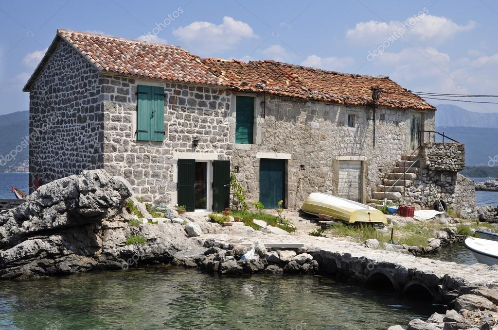 beautiful stone house near the sea stock photo