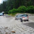 Car crossing a road flooded — Stock Photo #9939144