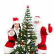 Santa Clause and Santa Giirl — Stock Photo