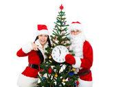 Santa Clause and Santa Giirl — Stock Photo