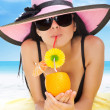 Summer vacation woman lying on beach yellow sand towel smile drink tropical cocktail  — Stock Photo
