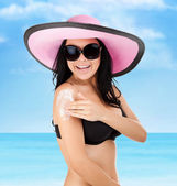 Beautiful young woman in black bikini — Stock Photo