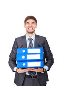 Businessman with stack blue folder happy smile — Stock Photo