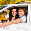 Stock Photo: Young happy couple driving