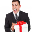 Businessman excited hold gift box — Stock Photo #31727329