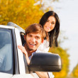 Young smile couple driving car — Stok fotoğraf