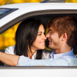 Couple romantic kissing sitting in car  — Stock Photo