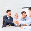 Smilling business people making a deal — Stock Photo #31729535