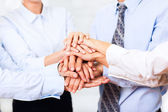 Business people team putting hands on top — Stock Photo