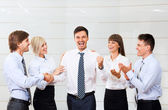 Applauding business people — Stock Photo