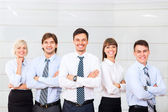 Business people group happy smile standing line at office — Stock Photo