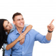 Happy couple in love excited smiling and pointing up — Stock Photo #31730523