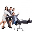 Excited Business people push colleague sitting in chair — Stock Photo #31730697