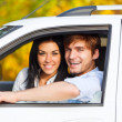 Young smile couple driving car — Stock Photo #31731949