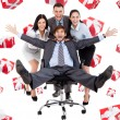 Business people group team push man leader colleague sitting in chair — Stock Photo #31732871