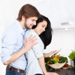 Couple using electronic tablet at their kitchen — Stock Photo