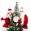 Santa Claus and christmas girl hold clock — Stok fotoğraf