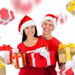 Excited couple wear red Christmas hats — Stock Photo #31733639
