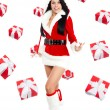 Santa christmas girl with  presents fall fly around — Stockfoto
