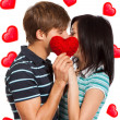 Love valentine day couple kiss holding red heart — Stockfoto