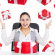 Business woman with red gift box — Stock Photo