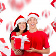 Excited couple wear red Christmas hats — Stock Photo #31734975