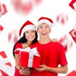 Excited couple wear red Christmas hats — Stock Photo