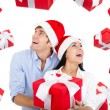 Christmas holiday happy couple hold present gift — Stock Photo