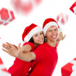 Excited couple wear red Christmas hats — Stock Photo #31735669