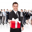 Businessman smile present gift red box in hand — Stock Photo #31738169
