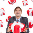 Business man hold red gift box sitting at the desk — Stok fotoğraf