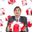 Business man hold red gift box sitting at the desk — Stock Photo
