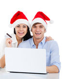 Christmas holiday couple shopping on line — Stock Photo