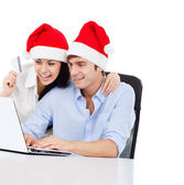 Christmas holiday couple shopping on line — Stock Photo