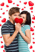 Love valentine day couple kiss holding red heart — Stock Photo