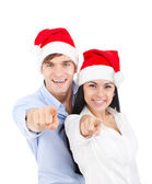 Christmas holiday couple point finger at you — Stock Photo