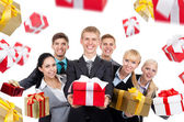 Business people group holding present gift — Stock Photo