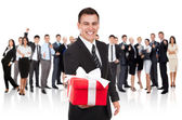 Businessman smile present gift red box in hand — Stock Photo