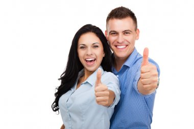 Happy couple in love excited smiling and holding thumbs up