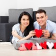 Young love couple holding lot of red valentine's hearts together — Stock Photo #31740295