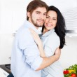 Happy couple cooking at their kitchen — Stock Photo #31740401