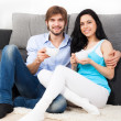 Couple sitting on floor and drinking coffee — Stock Photo #31740499
