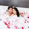 Young happy couple  lying in jacuzzi — Foto Stock