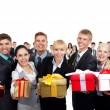 Businesspeople group holding present gift box — Stock Photo