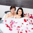 Young happy couple lying in jacuzzi — Stock Photo #31742497